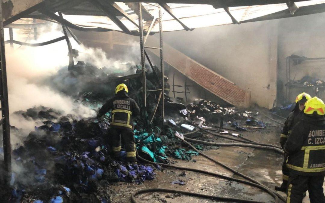 Evacúan dos suburbios de Atenas por un fuerte incendio
